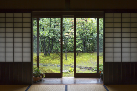 Traditional house interior in Japan, with open door to the garden