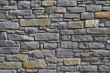 Grey tiled stone wall, construction material