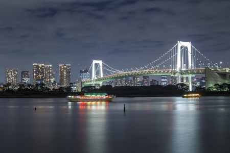 Tokyo skyline on the bay with Rainbow Bridge, shot from Odaiba
