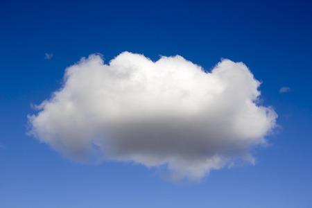 Single fluffy cloud against blue sky Stock Photo