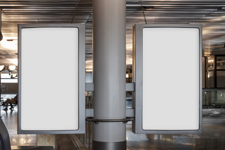 Blank billboard mock up in an airport, with unfocused background 스톡 콘텐츠