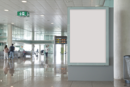 Blank billboard mock up in an airport, with unfocused background Imagens