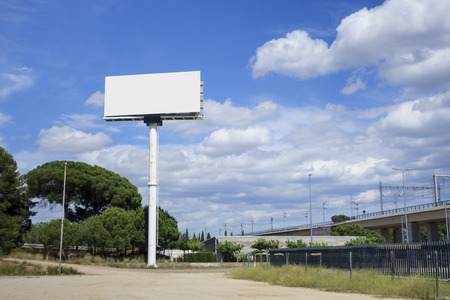 Blank billboard for advertising, against blue sky Stok Fotoğraf