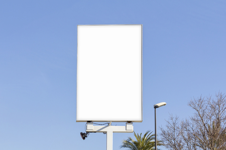 Blank billboard for advertising, against blue sky Фото со стока