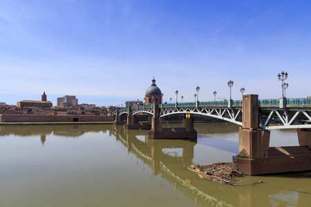 Saint Pierre bridge over the river Garonne in Toulouse, with the Dome de la Grave in the background