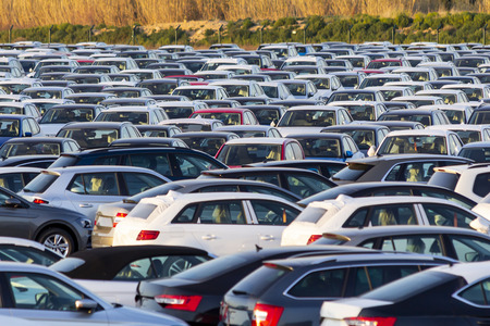 Lots of new cars for sale in a parking