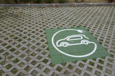 Electric charger symbol for cars, in a public parking