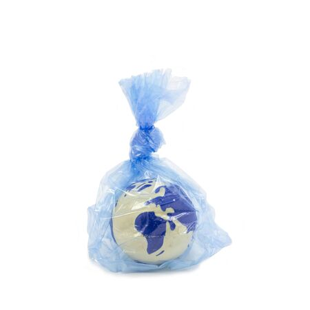 Earth globe inside a plastic bag, pollution and warming concept