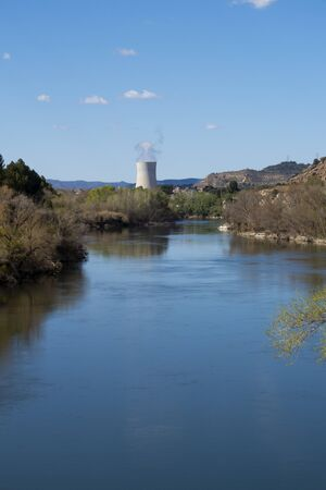 Steam chimney in a power nuclear plant, next to the river
