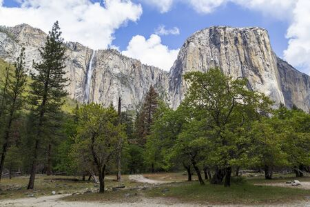 El Capitan granite mountain and waterfall in Yosemite National Park, United States