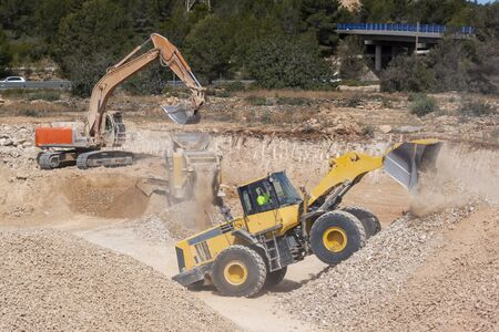 Excavator machines working in the construction site