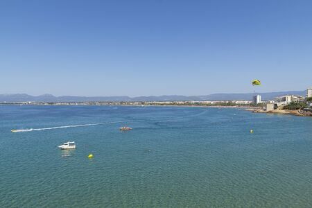 Time lapse in the sea of Salou, Spain. Busy coastline and beach at summer