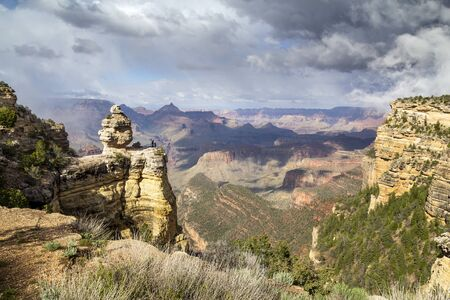 Scenic lookout with people in Grand Canyon, Arizona, United States