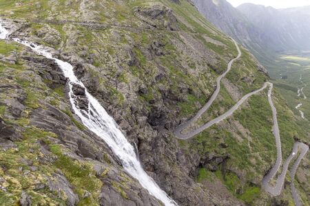Trollstigen serpentine road in Norway, a famous mountain pass with steep incline and hairpin bends.