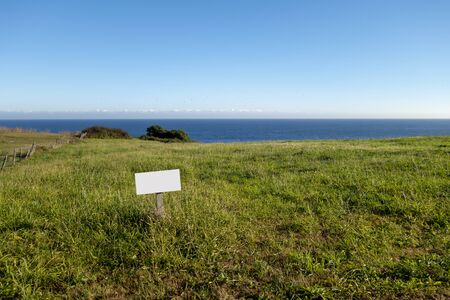 Blank billboard mock up in an on sale property in front of the sea