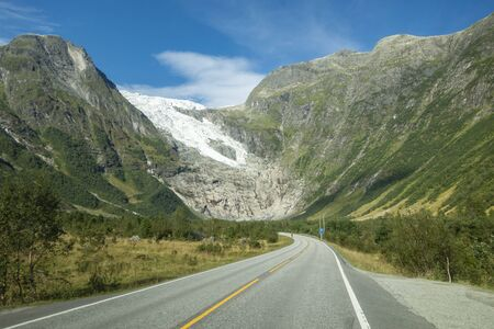 Mountain road with Josteldalsbreen glacier in the background, Norway