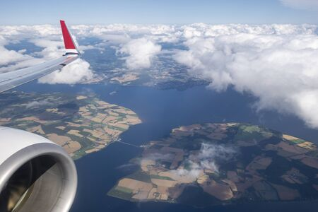 Airplane flying above a fjord in Norway Standard-Bild
