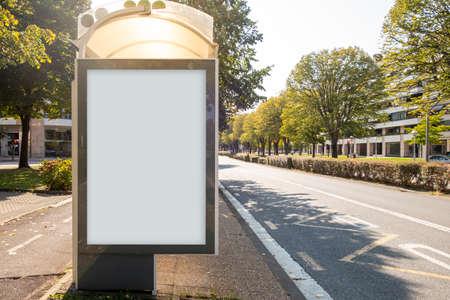 Blank billboard mock up in a bus stop, in the street