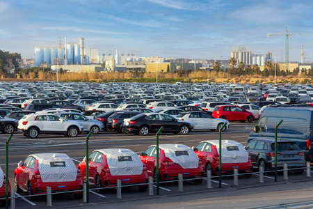 Import of new cars for sale in a parking, automotive industry