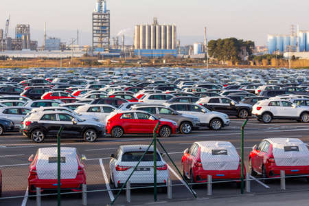 Import of new cars in the automotive industry, in a parking