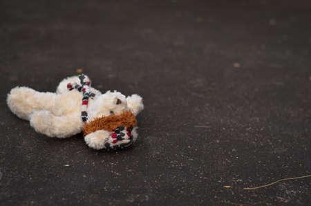lie down: teddy bear lie down on the floor Stock Photo
