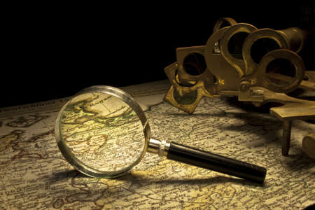 magnifying glass and sextant still life Stock Photo