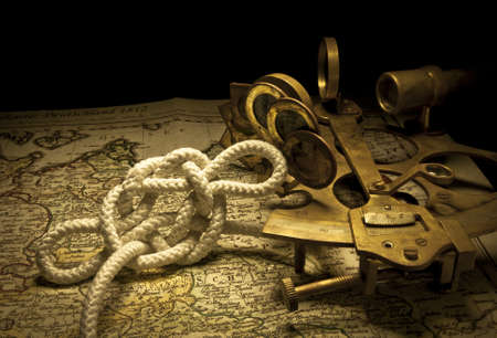 still life with a nautical sextant and a knot Stock Photo