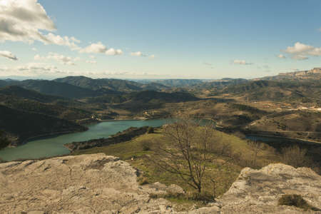 landscape of a valley with a reservoir Stock Photo