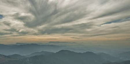 far mountains at sunset with high clouds