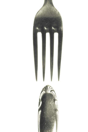 two parts of a fork on white background