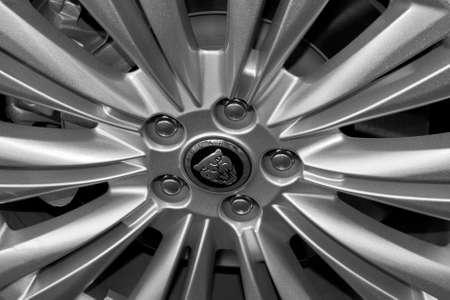 Detail of the wheel of a Jaguar car.