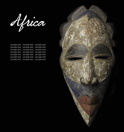 cultural history: African mask over black