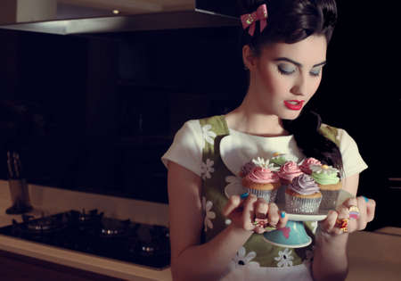 beautiful 50s pin up girl and cupcackes photo