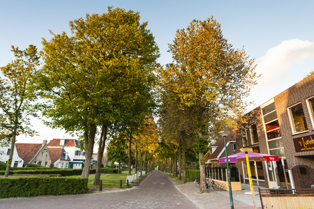 Straat met winkels en woningen; Street with shops and houses