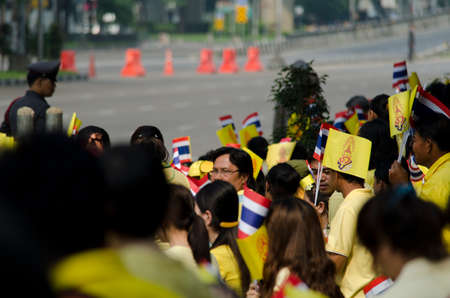 adulyadej: Celebration birthday of King Thailand   BANGKOK - DECEMBER 5  Thai people sit outside to celebrate for the 85th birthday of HM King Bhumibol Adulyadej on December 5, 2012 in Bangkok, Thailand