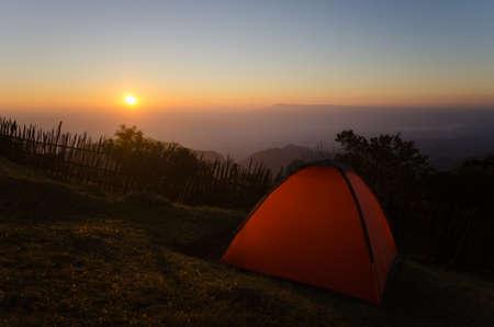 awaking: Tourist tent on mountain with sunset in thailand.