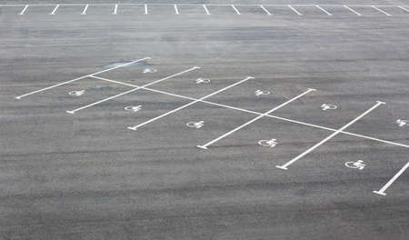 a lot  of: Markings on the asphalt for parking for disabled Stock Photo
