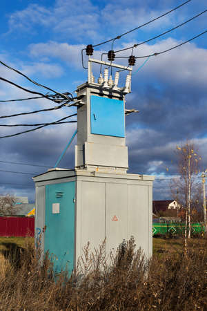 locating: Transformer of transmission line locating in the village Stock Photo