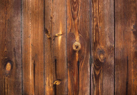 Old background of vertical natural tinted wood planks