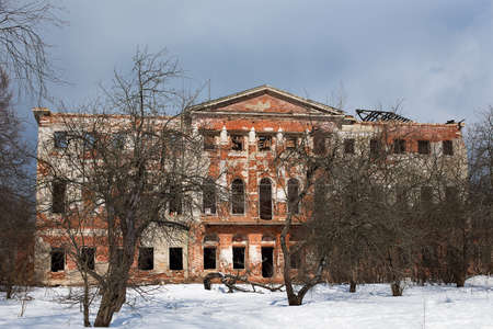 Abandoned Grebnevo mansion with old garden in winter