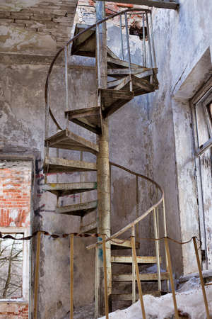 Abandoned metal circular stairs in Grebnevo mansion