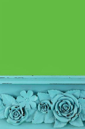craquelure: Carved blue flower on green background