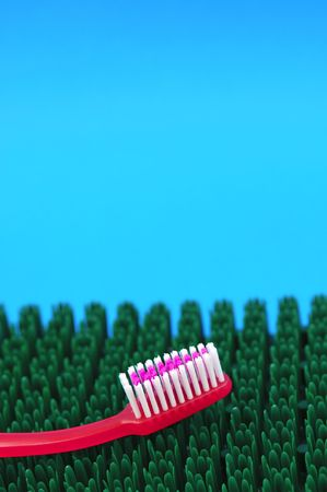 Pink toothbrush dental health concept