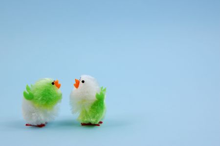 Two easter chicks on blue background
