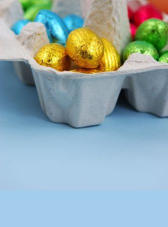 Foil Covered Easter Eggs in Egg Carton Stock Photo