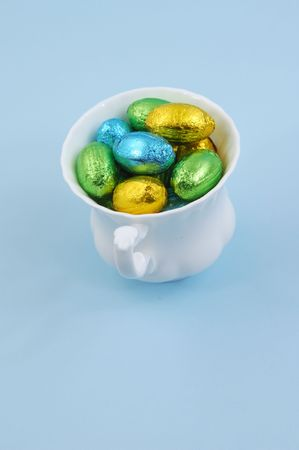 Chocolate easter eggs in cup