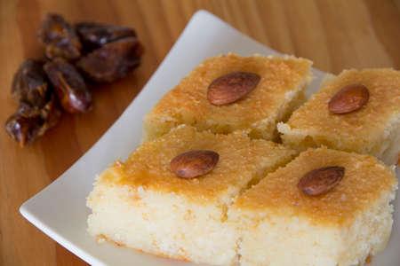 Basbousa with Dates on a Table
