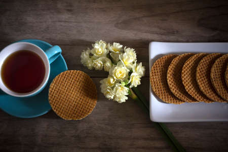 Dutch Waffles (Stroop Wafels) with Tea and Flowers photo