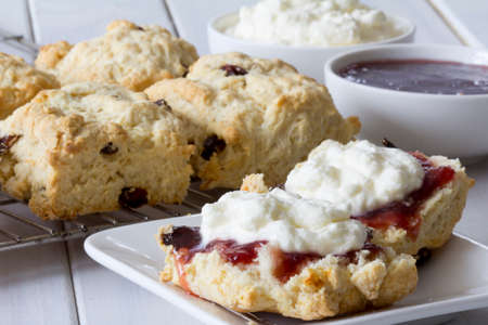 scones: Sultana Scones with Jam and Cream on the Table