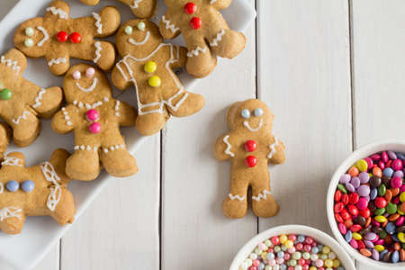 gingerbread cookie: Gingerbread Men with Decorations on a Plate Stock Photo
